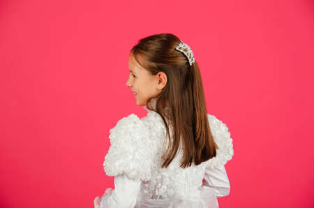The girl in a white dress on a pink background photo