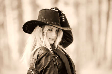 cowgirls: Girl in a black cowboy hat Stock Photo