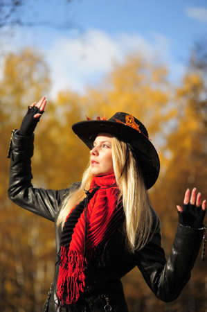 Girl in a black cowboy hat photo