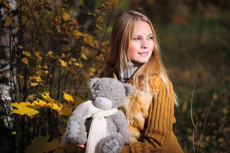 Pretty girl with teddy bear photo