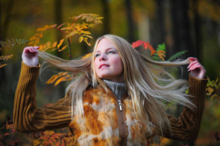 a beautiful young blonde in the background of autumn Stock Photo - 8419652