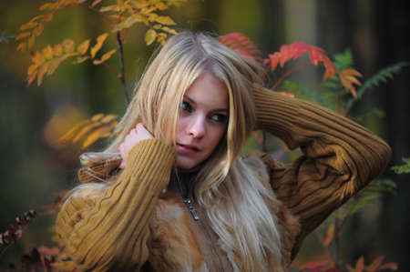 beautiful young woman in autumn park Stock Photo - 8419718