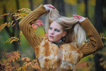 beautiful young woman in autumn park Stock Photo - 8419674