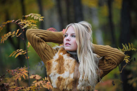 beautiful young woman in autumn park photo