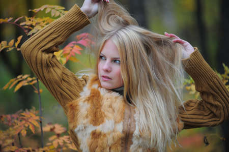 beautiful young woman in autumn park Stock Photo - 8419673