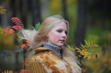 beautiful young woman in autumn park Stock Photo - 8419796