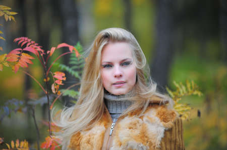 beautiful young woman in autumn park Stock Photo - 8419793