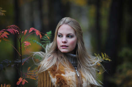 beautiful young woman in autumn park Stock Photo - 8419802