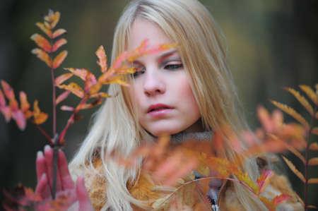 ocharovaetlny: beautiful young woman in autumn park