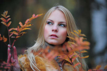 beautiful young woman in autumn park Stock Photo - 8419791