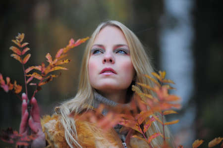 beautiful young woman in autumn park Stock Photo - 8419792