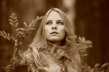 beautiful young woman in autumn park Stock Photo - 8419795