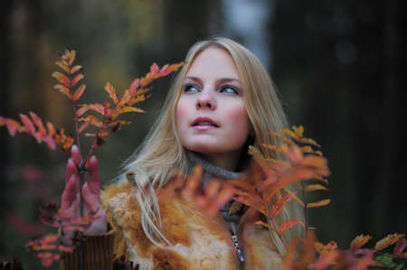 beautiful young woman in autumn park Stock Photo - 8419794