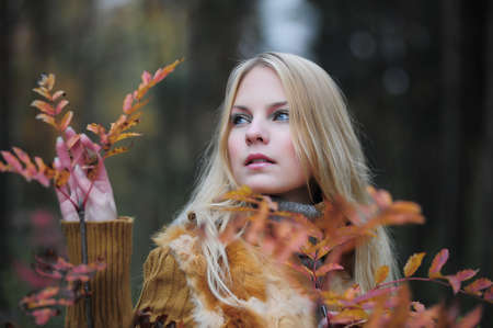 stuartkey: beautiful young woman in autumn park