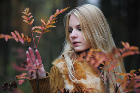 beautiful young woman in autumn park Stock Photo - 8419567