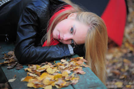 lying in leaves: Alone With Her Thoughts Stock Photo