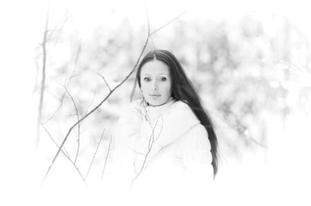 Young woman in coat outside in snow Stock Photo - 8297352