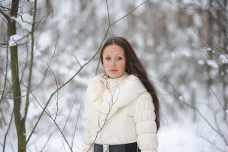 Young woman in coat outside in snow Stock Photo - 8297354