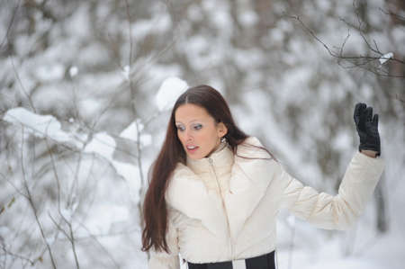 Young woman in coat outside in snow Stock Photo - 8297323