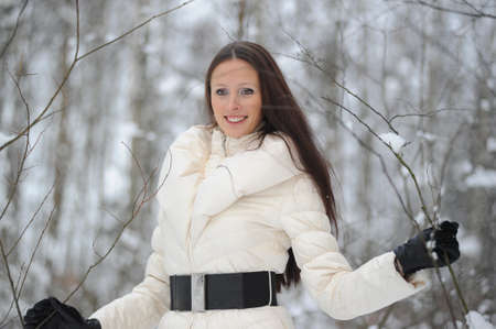 Young woman in coat outside in snow photo