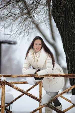 Girl leaning on a wooden rail bridge Stock Photo - 8297363