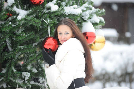 Young woman in coat outside in snow Stock Photo - 8296799