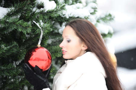 Young woman in coat outside in snow Stock Photo - 8296801