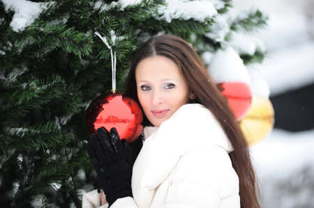 Young woman in coat outside in snow Stock Photo - 8296796