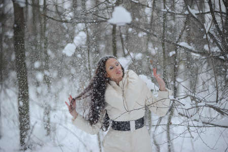 girl in a snowy forest photo