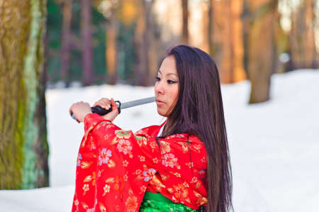 Young japanese woman with samurai sword fashion Stock Photo - 8418442