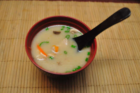 popular soup: Tom Kha Kai or Spicy Chicken Soup with Coconut Milk - Thai Popular Recipe Stock Photo