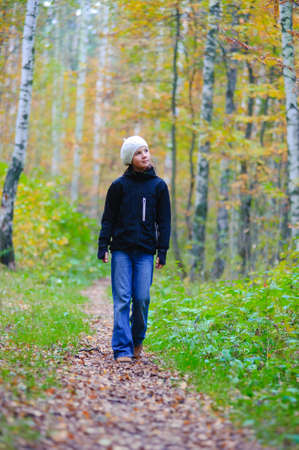 girl walking in autumn park Stock Photo - 8369804