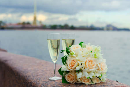 glasses of champagne and a bouquet