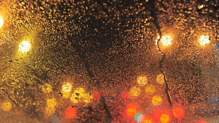 Raindrops over window glass closeup. blurred night background with coloured lights Stock Photo - 8412630