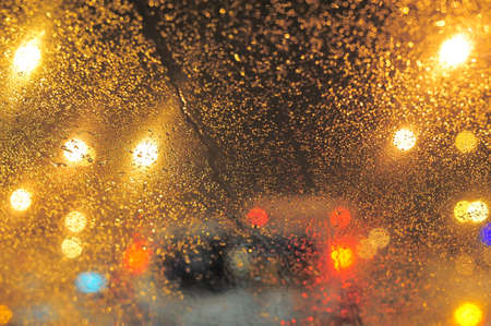 Raindrops over window glass closeup. blurred night background with coloured lights Stock Photo - 8412661