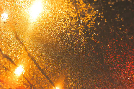 Raindrops over window glass closeup. blurred night background with coloured lights Stock Photo - 8412636