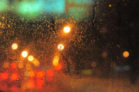 Raindrops over window glass closeup. blurred night background with coloured lights Stock Photo - 8412592