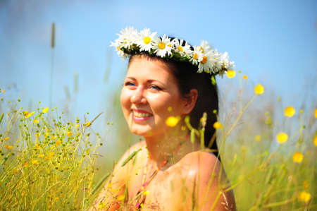 Brunette wearing a crown of daisies Stock Photo - 8719736