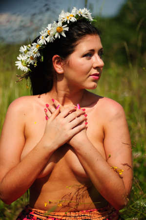 Brunette wearing a crown of daisies photo