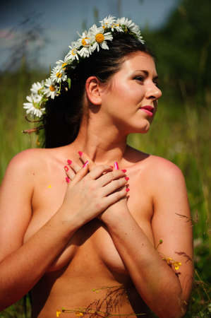 sun down: Brunette wearing a crown of daisies Stock Photo
