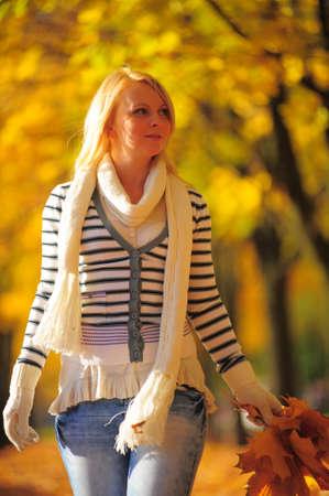Autumn - Close up portrait of young woman photo