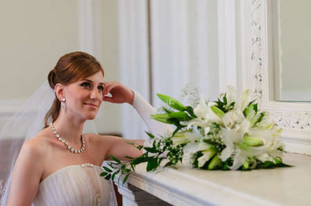 the bride with a bouquet of white lilies photo
