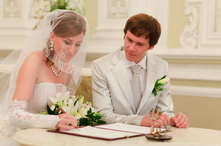 traditional celebrations: Couple Sign Wedding Register