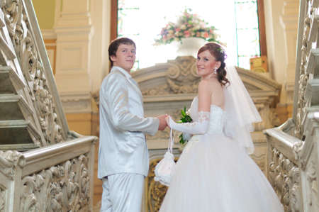 the bride and groom on stairs photo