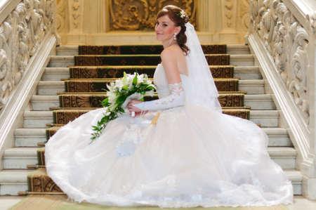 debutante: The bride at ladder steps Stock Photo