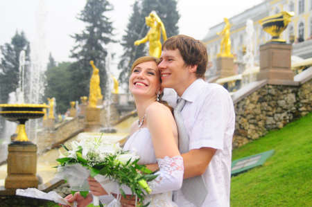the bride and groom at a wedding a walk in the parks of Peterhof, St. Petersburg, Russia Stock Photo - 8455859