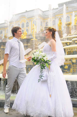 the bride and groom at a wedding a walk in the parks of Peterhof, St. Petersburg, Russia photo