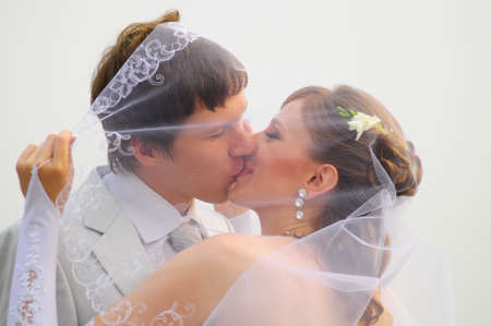 A couple about to kiss under a veil outdoors Stock Photo - 8456170