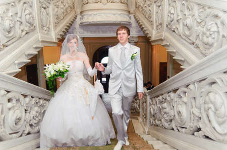Bride and groom walking up the stairs Stock Photo - 8455617