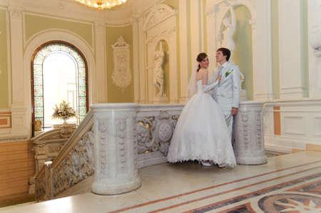 newlyweds in a beautiful palace photo